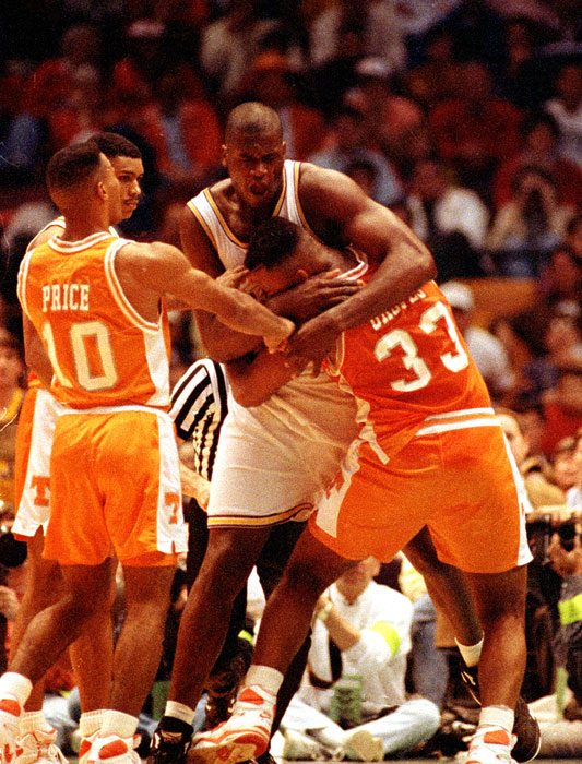 O'Neal wrestles with Tennessee's Carlus Groves during the second half of their 1992 SEC Tournament game in Birmingham. The wrestling escalated to a bench-clearing brawl that suspended play for 25 minutes.