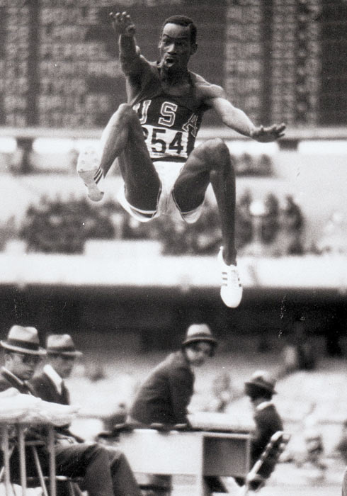 Bob Beamon sets an indoor record for the long jump with 27 feet, 2 3/4 inches. On October 17th at the Olympic Games in Mexico he would jump 29 feet, 2 1/2 inches.
