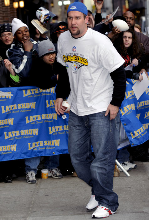 "Roethlisberger walks by fans on his way inside the Ed Sullivan Theater in New York City for an appearance on  visits the ""Late Show with David Letterman."""