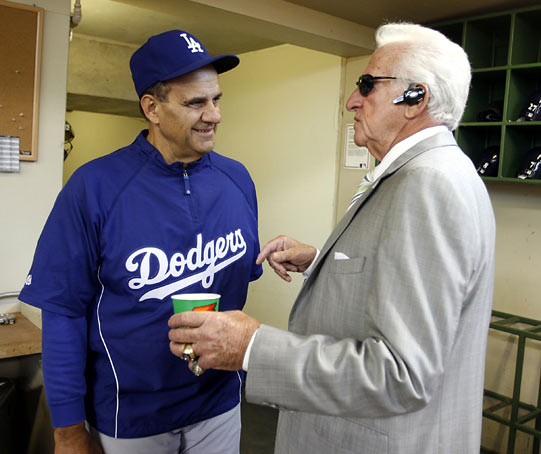 Uecker and Torre, former teammates in Milwaukee, share a laugh before a Dodgers-Brewers game.