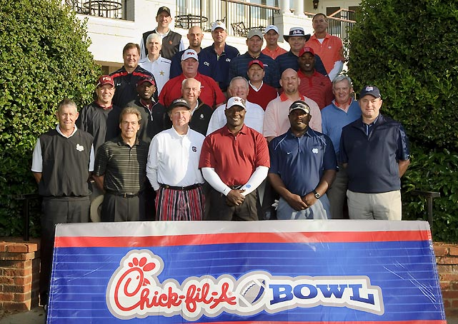 "A field that included four past Heisman Trophy winners, 10 members of the College Football Hall of Fame, 20 All-Americas, six coaches of the year, four NFL Hall of Famers and 51 NFL All-Pro or Pro Bowl players recently took to Reynolds Plantation resort on Lake Oconee outside Atlanta to play for $400,000 in scholarship money at the annual Chick-fil-A Bowl Challenge charity golf tournament.  Making up the pairings were Nick Saban and Steve Sloan (Alabama), Dabo Swinney and Dwight Clark (Clemson), Jimbo Fisher and Terrell Buckley (Florida State), Paul Johnson and Jon Barry (Georgia Tech), Ralph Friedgen and Stan Gelbaugh (Maryland), Houston Nutt and Wesley Walls (Ole Miss), Butch Davis and Natrone Means (North Carolina), Monte Towe and Sidney Lowe (North Carolina State), Steve Spurrier and Sterling Sharpe (South Carolina), Bobby Johnson and Will Perdue (Vanderbilt), Frank Beamer and Brad Clontz (Virginia Tech) and Jim Grobe and Billy Packer (Wake Forest).  ""Each year, the coaches have gone recruiting for a better player, a better celebrity,"" said Chick-fil-A Bowl CEO Gary Stokan. ""Like Houston Nutt went and got Wesley Walls this year. The first year Steve Spurrier had Darius Rucker of Hootie & the Blowfish, then he went and got Sterling Sharpe. ...These coaches really get competitive and they love to recruit, so they're out there making sure they get great players."""