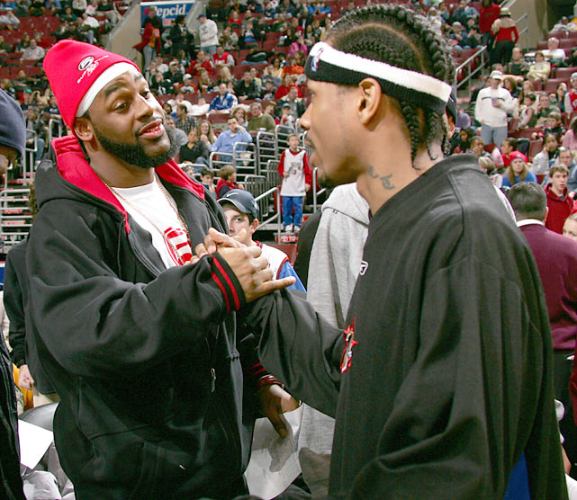 McNabb and Allen Iverson - arguably the two biggest sports stars in Philadelphia during the 2000s - greet one another before a Sixers-Heat game.