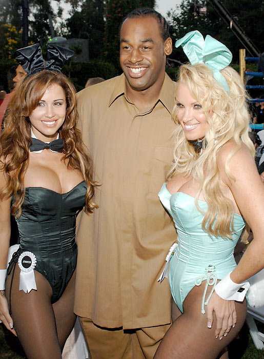McNabb unwinds at the Playboy mansion with a couple Playmates on his arm.