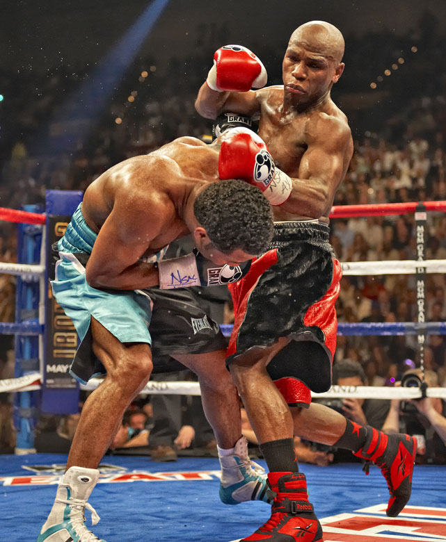 Mayweather, nearly a 5-to-1 favorite against the veteran Mosley, was rocked with a pair of right hands early in the second round. But Sugar Shane wouldn't (or couldn't) finish the job as Mayweather coasted to a lopsided points victory.