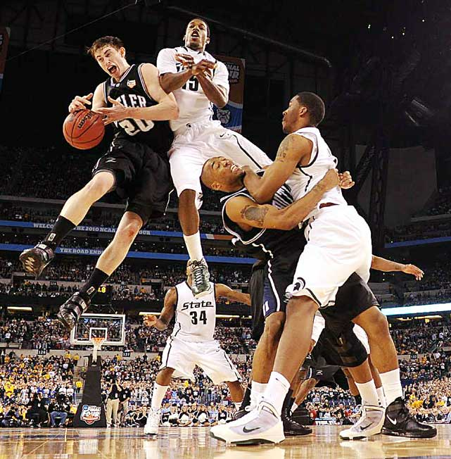Butler's Gordon Hayward (20) collides with Michigan State guard Durrell Summers while battling in a semifinal game at the Final Four on April 3 in Indianapolis. Hayward had a game-high 19 points as Butler advanced, 52-50.