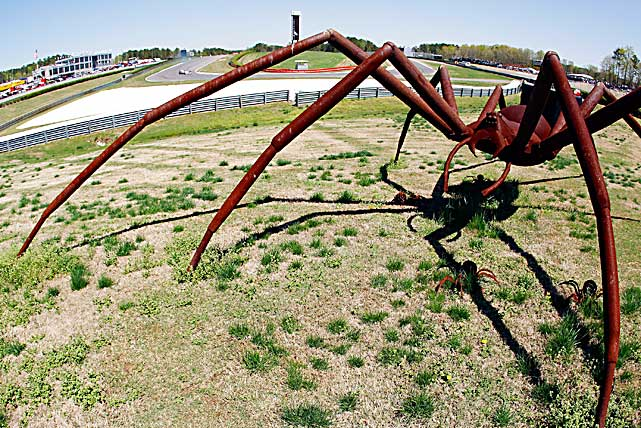 A sculpture of a giant spider sits near the track during practice for the Indy Grand Prix of Alabama on April 9.