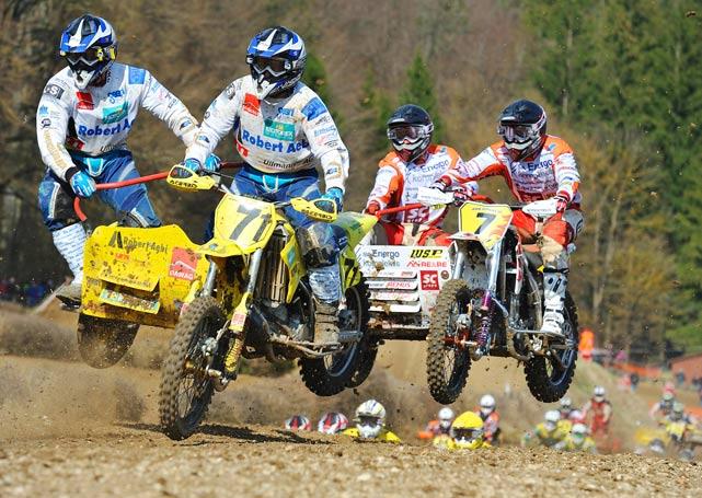 Emil Cook and Marius Strauss of Switzerland lead Maris Rupeiks and Kaspars Stupelis of Latvia during the ADAC German Moto Cross Championship on April 11.
