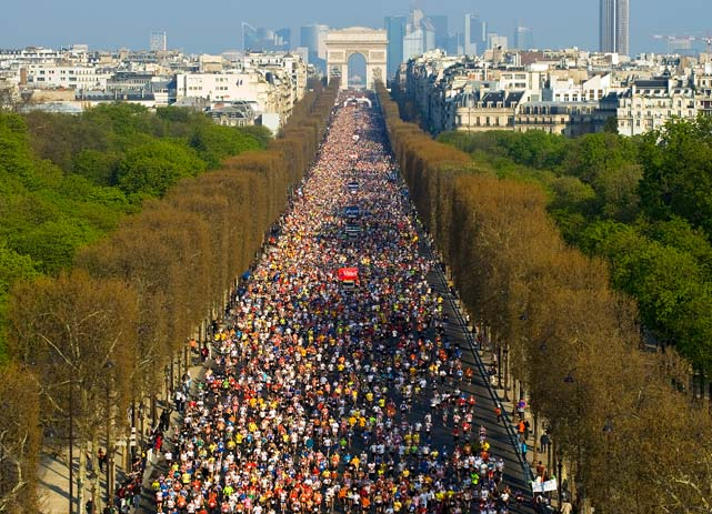 Thousands of runners crowd the Champs Elysees on April 11 at the start of the 34th Paris Marathon. According to the organizers, 40,000 athletes took part in this year's event. Tadesse Tola of Ethiopia won with a time of 2:06:41.
