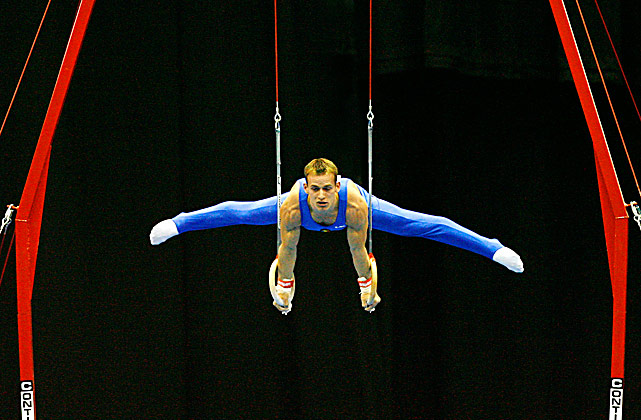 Flavius Koczi of Romania performs on the rings during at the European Artistic Gymnastics Team Championships. The event was held at the National indoor Arena on April 23 in Birmingham, England.