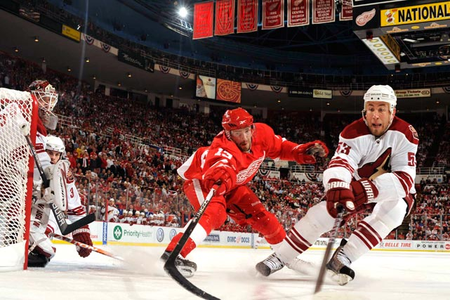 Phoenix defenseman Derek Morris tangles with Detroit Red Wings center Pavel Datsyuk during the Red Wings' 3-0 victory at Joe Louis Arena in Detroit that tied the series at 2-2.