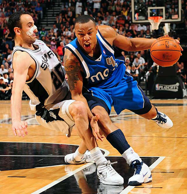 Dallas Mavericks forward Caron Butler drives into San Antonio Spurs guard Manu Ginobli during Game 4 on April 25 in San Antonio. The Spurs defeated the Mavericks 92-89 to take a 3-1 lead in the series.