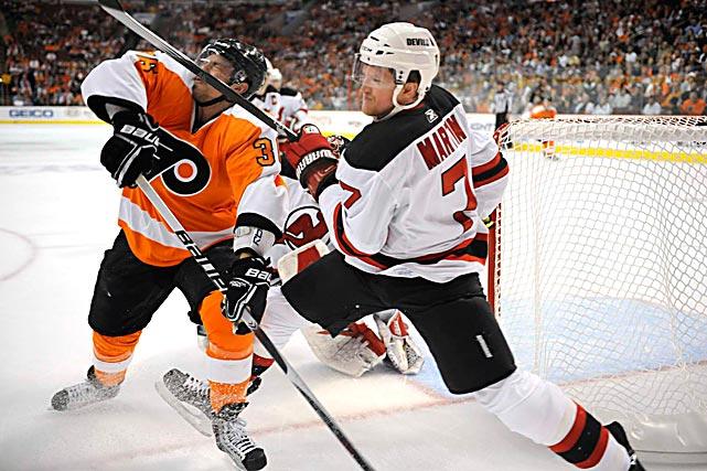 Philadelphia Flyers center Darroll Powe gets a stick to the face by New Jersey Devils defenseman Paul Martin during Game 4 of their first round playoff series on April 20 at the Wachovia Center in Philadelphia. The Flyers won 4-1 to take a 3 games to 1 lead in the series.