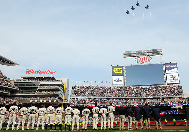 Four F-16s from the Minnesota Air National Guard did a flyover the end of the national anthem.