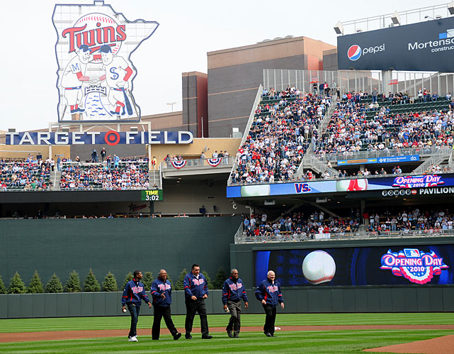 Kirby Puckett Jr. (representing his late father Kirby), Tony Oliva, Kent Hrbek, Rod Carew, and Harmon Killebrew walk across the infield of new Target Field as part of the opening day ceremonies.