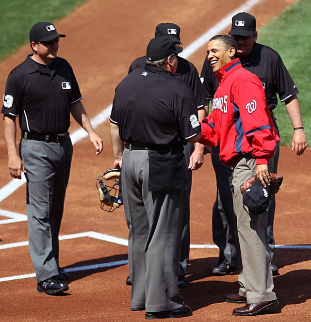 President Barack Obama greets umpires after throwing out the first pitch at Nationals Park in Washington, D.C.