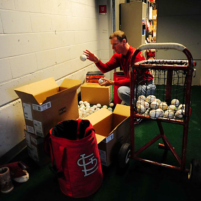 St. Louis Cardinals batting practice pitcher Dennis Schutzenhofer gets balls ready prior to the game at Great American Ballpark.