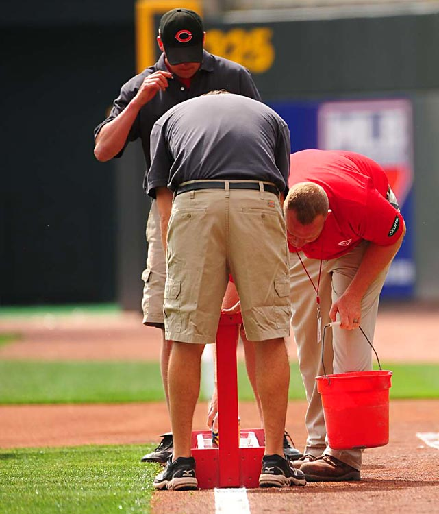 Reds groundskeepers lay down foul lines at Great American Ballpark.