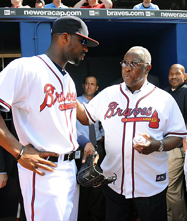 Atlanta Braves rookie phoenom Jason Heyward meets with Hall of Famer Hank Aaron before the start of Atlanta's game versus the Cubs at Turner Field. Heyward homered in his first big league at bat.
