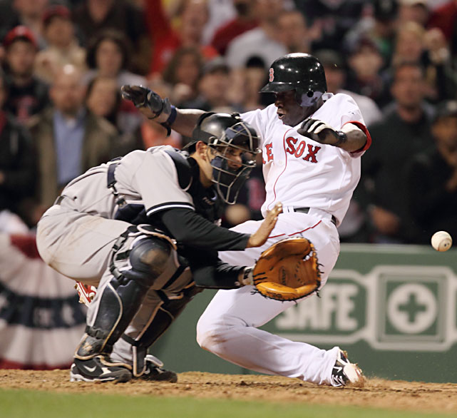Boston's Mike Cameron scores past New York Yankees catcher Jorge Posada in the eighth inning on Opening Night.