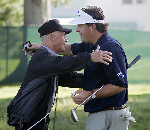 Mickelson hugs his father, Phil Sr., during a practice round at Winged Foot Golf Club in Mamaroneck, N.Y.
