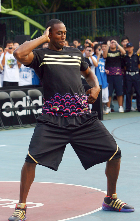 Howard led a basketball (and dancing) clinic in Shanghai as part of his tour in China in 2009.