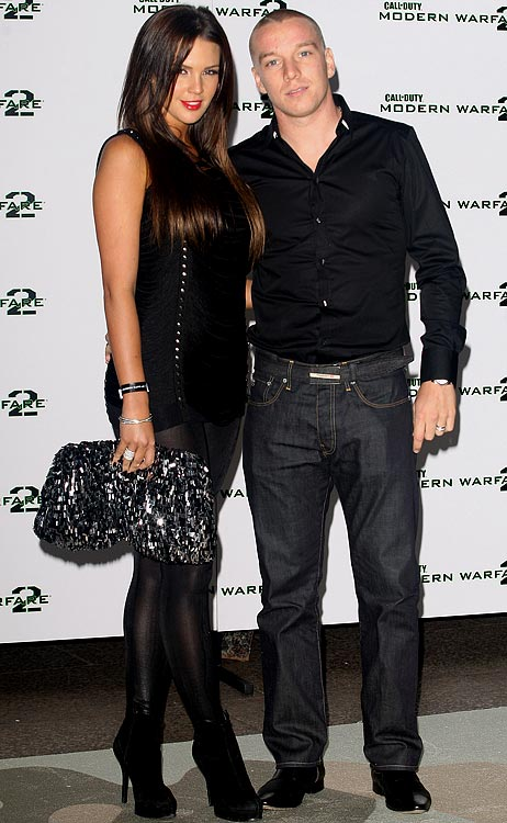 Model Danielle Lloyd and fiancé, English midfielder Jamie O'Hara (Portsmouth), attend the launch of Call of Duty: Modern Warfare 2.