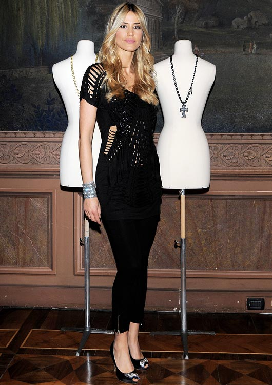 Model Elena Santarelli, fiancée of Italian striker Bernardo Corradi (Udinese), attends a fashion show in Milan.