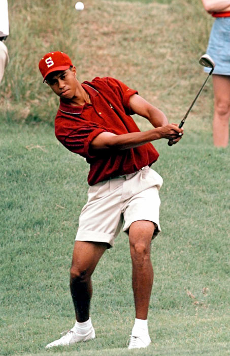 Tiger chips onto the sixth green during the NCAA Men's Golf Championship in May of 1996.