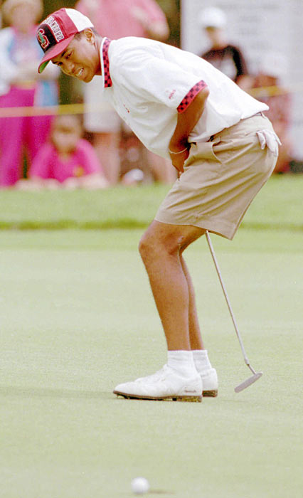 Woods shows his disgust after missing a short putt.