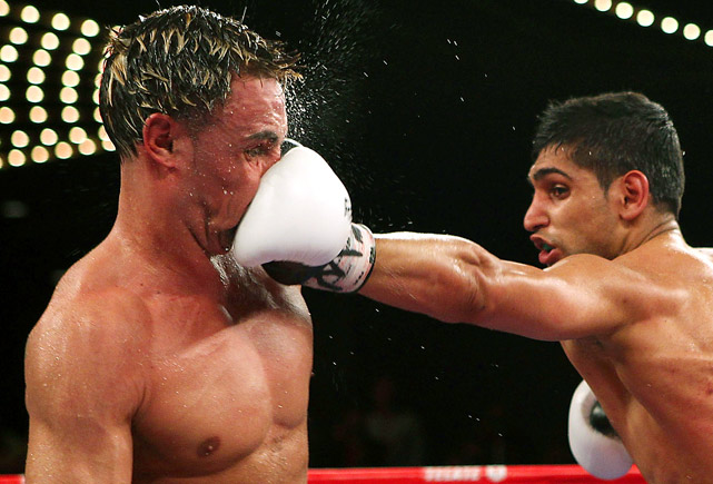 Amir Khan of Great Britain defeated Paulie Malignaggi during their WBA light welterweight title fight at Madison Square Garden on May 15.