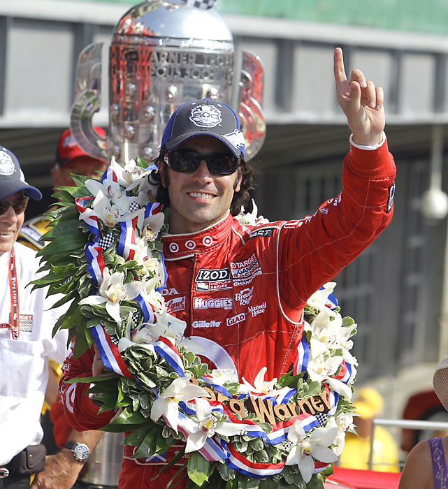 Just seconds after sampling the traditional Indy winner's drink of choice (milk), Dario Franchitti is adorned by a champion's wreath as he stands in front of the Borg-Warner trophy.