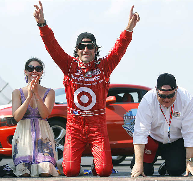 Ashley Judd, Dario Franchitti and team owner Chip Ganassi celebrate the Indy 500 victory with a traditional kiss of the bricks.
