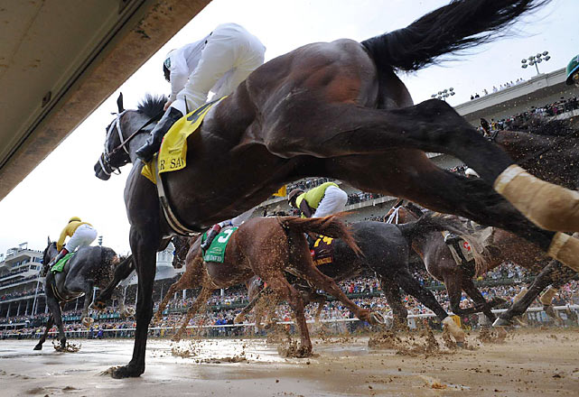 Sloshing through the slop aboard Super Saver, jockey Calvin Borel won his third Kentucky Derby in four years.