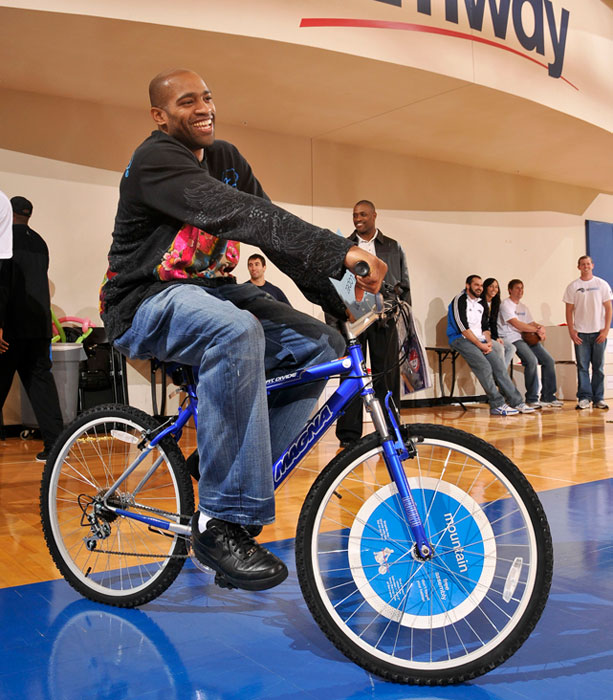 Vince Carter clowns around during a holiday party at Orlando's RDV Sportsplex.