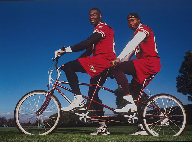 49ers receivers Terrell Owens and J.J. Stokes bond over a ride on a tandem bike.