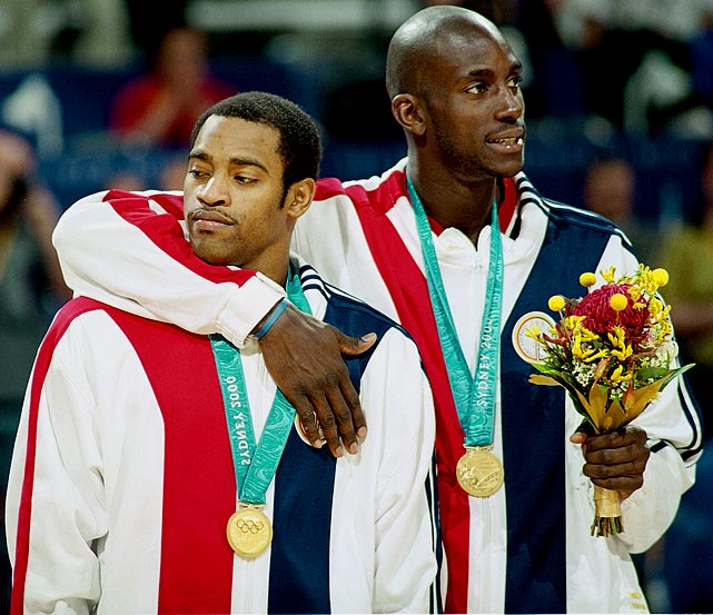 Garnett puts his arm around Vince Carter after leading Team USA to the gold medal in Sydney.
