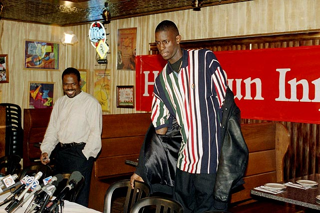 Garnett and his Farragut Academy coach, William Nelson, arrive at a news conference to announce Garnett's intention of skipping college to jump directly to the NBA.