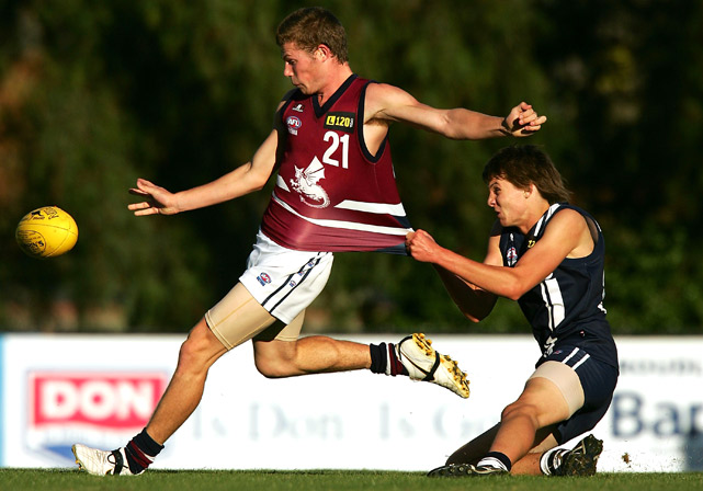 Jake Dermott of the Dragons is tackled by Jarryn McCormack of the Falcons during the round five TAC Cup match between the Geelong Falcons and the Sandringham Dragons at Chirnside Park on May 1 in Melbourne, Australia.