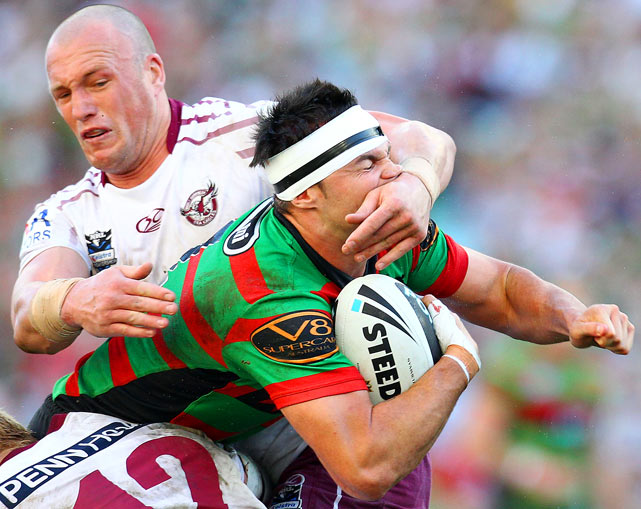 Beau Champion of the Rabbitohs is tackled high by Matt Cross of the Eagles during the round eight NRL match between the South Sydney Rabbitohs and the Manly Sea Eagles at ANZ Stadium on May 2 in Sydney, Australia.
