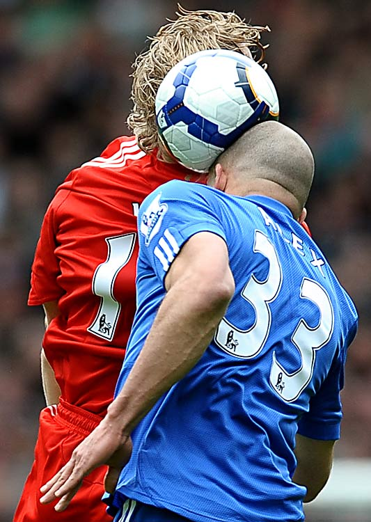 Chelsea's Alex from Brazil, heads the ball under a challenge from Liverpool's Dirk Kuyt from Holland during the Premiership football match on May 2 at Anfield in Liverpool.
