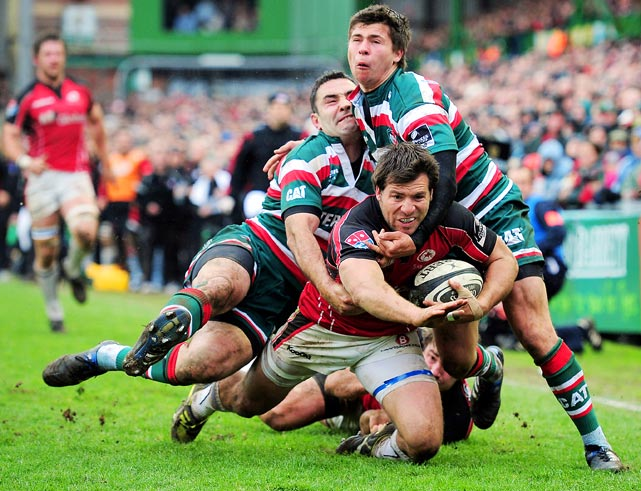 Schalk Brits of Saracens is tackled by Jeremy Staunton and Ben Youngs during the Guinness Premiership match between the Leicester Tigers and Saracens at Welford Road on May 8 in Leicester, England.