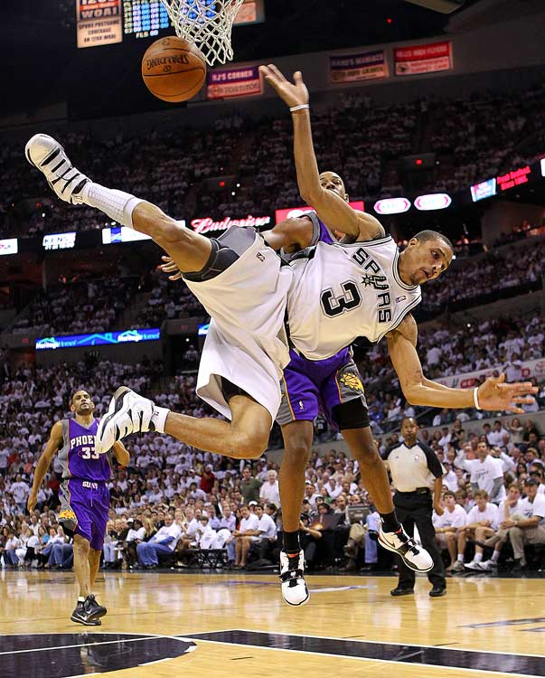Spurs guard George Hill is fouled by Channing Frye during Game 3 of the Western Conference semifinals at the AT&T Center in San Antonio. Phoenix won 110-96 on May 7 and completed the sweep two days later.