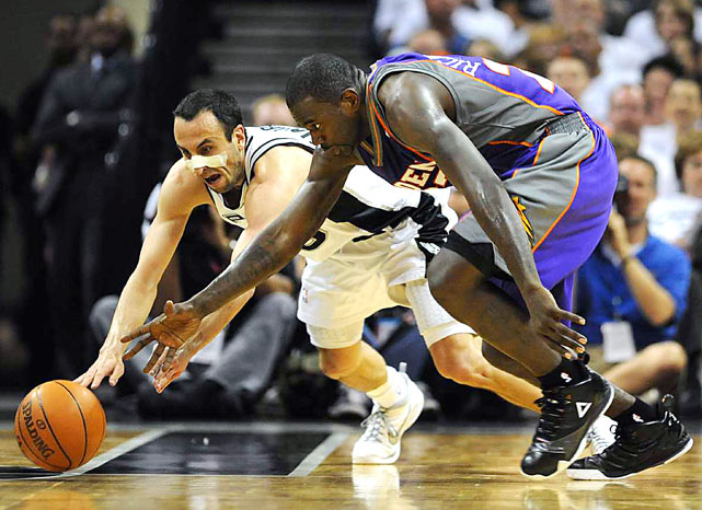 Spurs guard Manu Ginobili grapples with Phoenix guard Jason Richardson during Game 3 of their second-round playoff game.