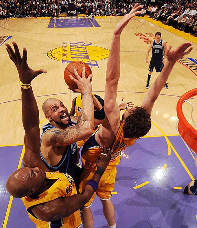 Utah Jazz forward Carlos Boozer drives to the basket against Lamar Odom and Pau Gasol during a 111-103 loss to the Los Angeles Lakers in Game 2 of their Western Conference semifinal at the Staples Center on May 4.