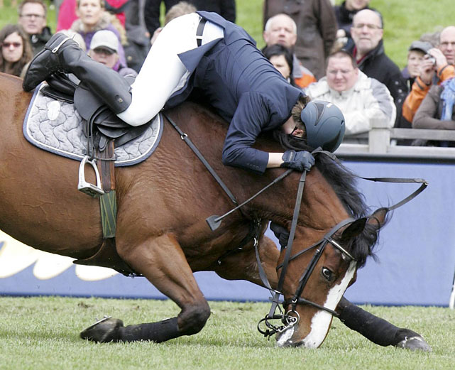 Dirk Viebrock, aboard Shamrock, falls during the second qualification run at the German Jumping and Dressage Derby in Hamburg on May 14. Viebrock and Shamrock were eliminated, finishing in 38th place.