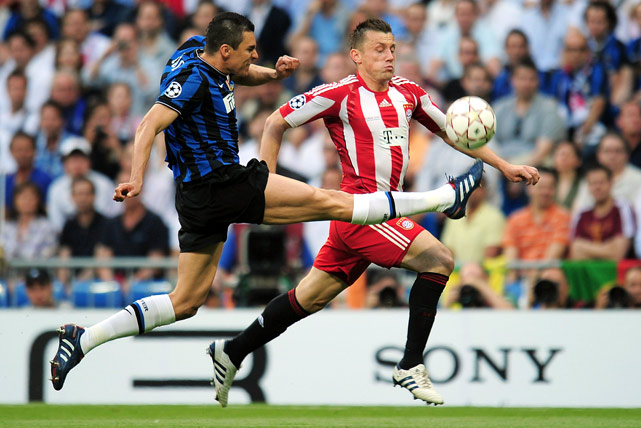 Ivica Olic of Bayern Muenchen is challenged by Lucio of Inter Milan during the UEFA Champions League Final on May 22 in Madrid.