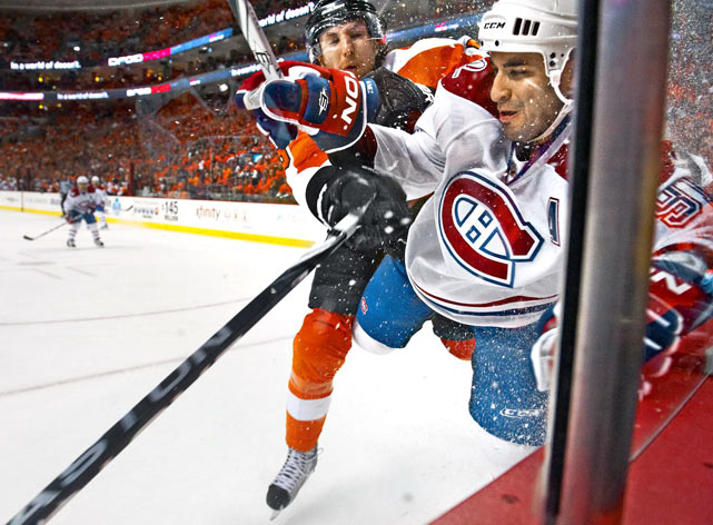 Flyers defenseman Braydon Coburn parked Montreal center Scott Gomez hard by the boards during Game 2 of the Eastern Conference Finals in Philadelphia on May 18. Coburn & Co. won 3--0 to take a 3--1 series lead.