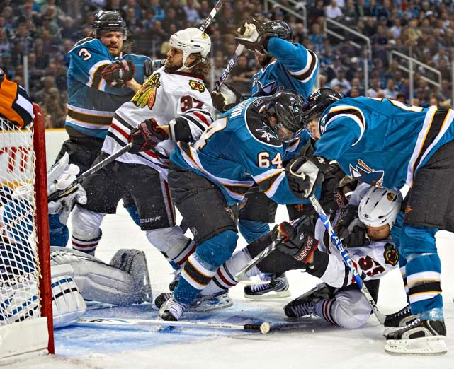 San Jose Sharks Douglas Murray (3), Jamie McGinn (64), Scott Nichol (21)and Dan Boyle (22) fight for the puck with Chicago's Ben Eager (55) and Adam Burish (37) during the second game of the Western Conference Finals on May 18 at HP Pavilion in San Jose. The Blackhawks took a 2-0 series lead with their 4-2 victory. They went on to sweep the Sharks and advanced to the finals for the first time since 1992.