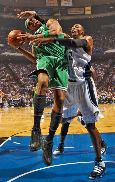 Dwight Howard of the Magic fouls Paul Pierce of the Boston Celtics during Game 2 of the NBA Eastern Conference Finals in Orlando on May 18. The Celtics won 95-92 to take a 2-0 lead in the series.