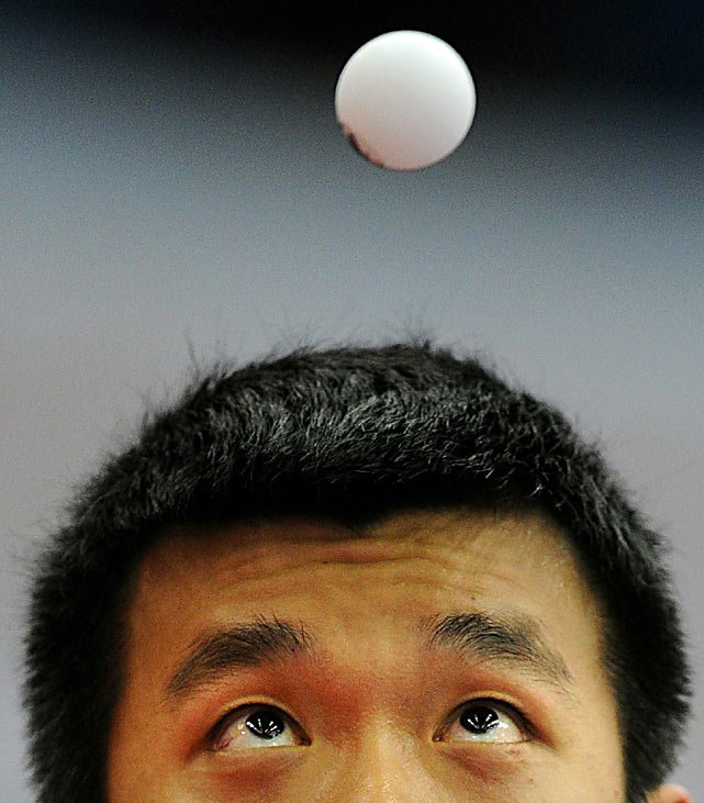 Hong Kong's Peng Tang looks at the ball during his quarterfinal match against Japan's Jun Mizutani at the World Team Table Tennis Championships in Moscow on May 28.